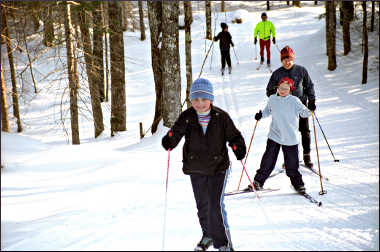 Skiers on trails at Afterglow Resort.