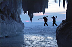 Photographers leave the ice caves at dusk.