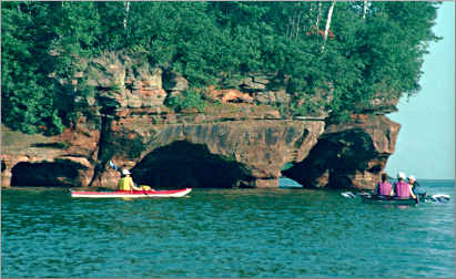 Kayakers at the Sand Island sea caves.