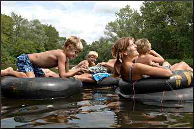 A family tubes on the Apple River.