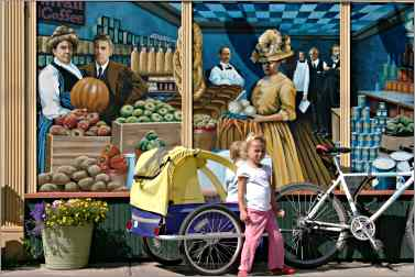 Child in front of Ashland co-op mural