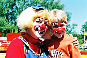 At Circus World, a clown poses with a boy.