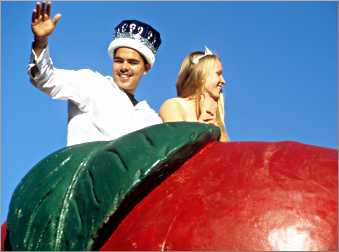 Bayfield Apple Fest royalty wave from a giant float.