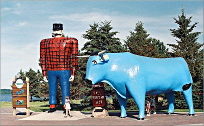 Paul Bunyan and Babe stand beside Lake Bemidji.