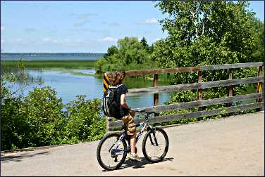 A bicyclist on the Paul Bunyan Trail.
