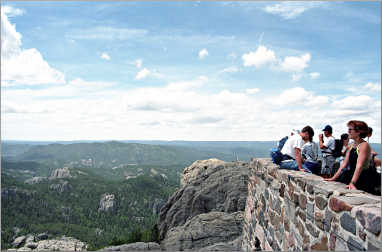 Hikers atop Harney Peak in the Black Hills.