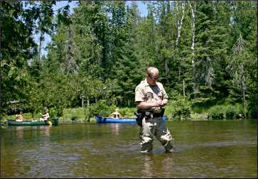 A warden on the Bois Brule River.