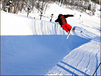 A snowboarder on a superpipe.