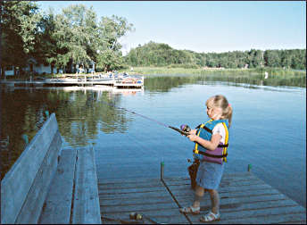 A girl fishing at a Brainerd resort.