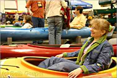 shopper for kayak at Canoecopia in Madison