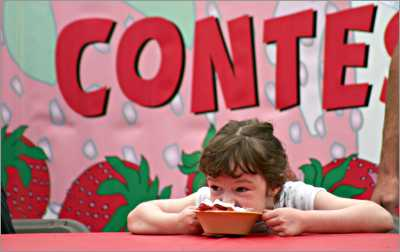 A girl gobbles strawberry shortcake in Cedarburg