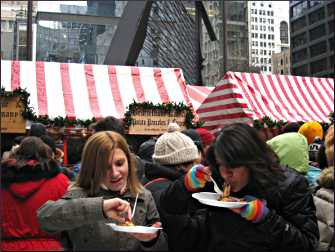 Eating potato pancakes at Christkindlmarket.