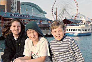 Children pose by Navy Pier in Chicago.