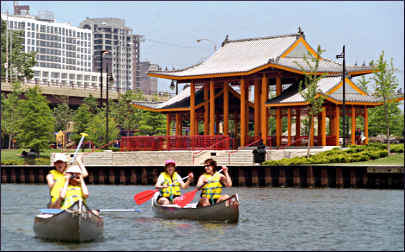 Canoeing in Chicago past Chinatown.