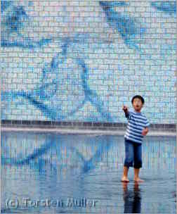 Child in reflecting pool in chicago's millenium park