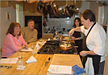A chef teaching a cooking class.