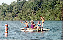 A family gathers on a raft.