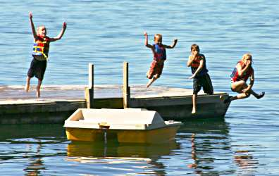 Kids jump off the raft at a Minnesota lake resort.