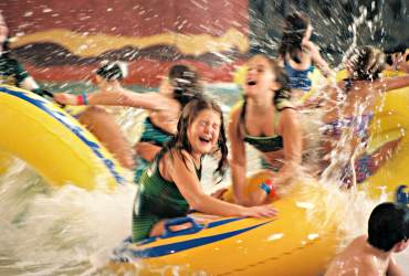 Children ride tubes at an indoor water park in the Wisconsin