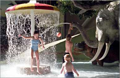 Children play in a water park.