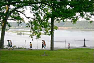 a family walks along Eagle Point Park in Dubuque