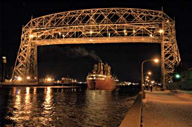 A boat under the Aerial Lift Bridge.
