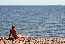 Sunbathing at Brighton Beach in Duluth.