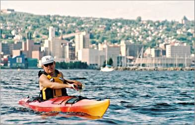 A kayaker paddles off Duluth's Park Point.