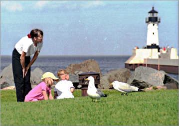 Kids talk to gulls on Duluth's Canal Park.