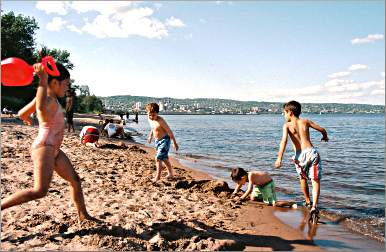 Kids play on the Park Point beach.