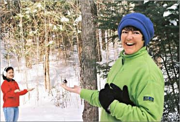 Feeding the chickadees on the Anvil Lake Trail.