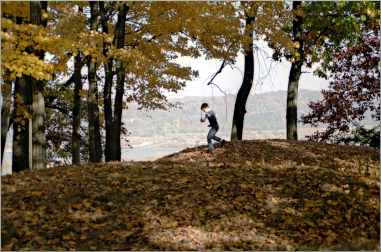 A boy plays in Effigy Mounds National Monument.