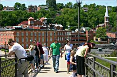 In Galena, tourists watch a canoe race.