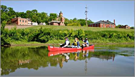 Paddlers in canoe see Galena from river.