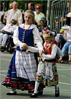 Girls in traditional clothing dancing