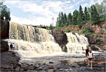Kids play at Gooseberry Falls.