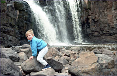 A child on the rocks at Gooseberry Falls.