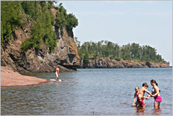Swimmers at the mouth of the Gooseberry River.