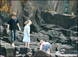 Kids play on the rocks in Grand Marais.