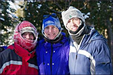 Three skiers on the Gunflint Trail.
