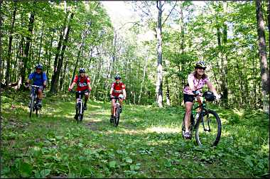 Mountain biking on the Birkie Trail.