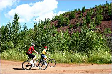Bicyclists on the Mesabi Trail.