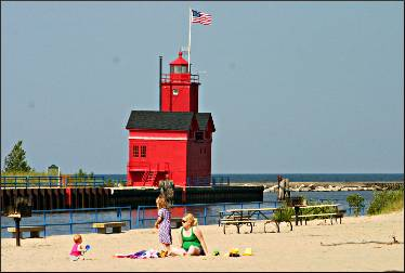The beach and lighthouse at Holland State Park.