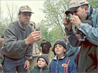 A naturalist bands a bird at the Horicon Marsh.