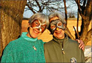 Sisters with painted faces at Owl Fest.