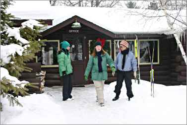 Skiers in front of Mississippi Headwaters Hostel in Itasca.