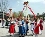 Dancers circle the maypole during Maifest in Amana.