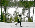 A skier passes Norberg Lake in Bear Head Lake State Park.