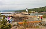 People walking on the Grand Marais breakwall.
