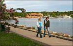 People walking around Geneva Lake.